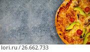 Купить «Fresh pizza on gray table», фото № 26662733, снято 23 июля 2019 г. (c) Wavebreak Media / Фотобанк Лори