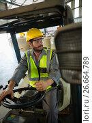 Купить «Worker driving a forklift car», фото № 26664789, снято 22 марта 2017 г. (c) Wavebreak Media / Фотобанк Лори