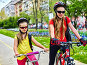 Bicycle path with children. Girls wearing helmet with rucksack ., фото № 26666449, снято 9 апреля 2016 г. (c) Gennadiy Poznyakov / Фотобанк Лори