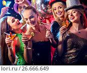 Купить «Dance party with group people dancing and disco ball.», фото № 26666649, снято 29 марта 2017 г. (c) Gennadiy Poznyakov / Фотобанк Лори