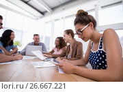 Купить «Female executive using digital tablet in the office», фото № 26667221, снято 26 марта 2017 г. (c) Wavebreak Media / Фотобанк Лори
