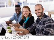 Купить «Happy executives using digital table in conference room», фото № 26667249, снято 26 марта 2017 г. (c) Wavebreak Media / Фотобанк Лори