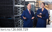 Купить «man and woman winemakers in wine cellar», фото № 26668729, снято 27 мая 2019 г. (c) Яков Филимонов / Фотобанк Лори