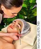 Купить «Mud facial mask of woman in spa salon. Face massage .», фото № 26670749, снято 19 марта 2017 г. (c) Gennadiy Poznyakov / Фотобанк Лори