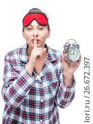 "Купить «Beautiful girl with a lip gesture ""QUIET"" holds an alarm clock in the evening on a white background», фото № 26672397, снято 2 января 2017 г. (c) Константин Лабунский / Фотобанк Лори"