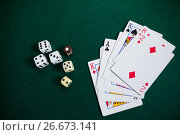 Купить «Playing cards and dices on poker table», фото № 26673141, снято 6 апреля 2017 г. (c) Wavebreak Media / Фотобанк Лори