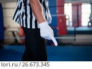 Купить «Midsection of male referee pointing down», фото № 26673345, снято 22 января 2017 г. (c) Wavebreak Media / Фотобанк Лори