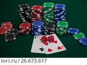 Купить «Playing cards, dices and casino chips on poker table», фото № 26673617, снято 6 апреля 2017 г. (c) Wavebreak Media / Фотобанк Лори
