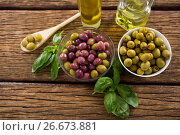 Купить «Marinated olives with ingredients», фото № 26673881, снято 15 февраля 2017 г. (c) Wavebreak Media / Фотобанк Лори