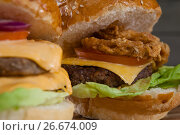Купить «Close-up of hamburgers», фото № 26674009, снято 13 января 2017 г. (c) Wavebreak Media / Фотобанк Лори