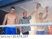 Купить «Referee holding hands of winning male boxer by athlete», фото № 26674297, снято 22 января 2017 г. (c) Wavebreak Media / Фотобанк Лори