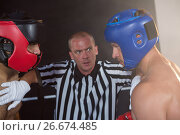 Купить «Referee stopping aggressive male boxers», фото № 26674485, снято 22 января 2017 г. (c) Wavebreak Media / Фотобанк Лори