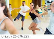 Купить «Young woman is dancing rock-n-roll with partner», фото № 26676225, снято 21 июня 2017 г. (c) Яков Филимонов / Фотобанк Лори