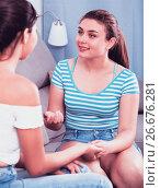 Купить «Cheerful teens girls blabbing on sofa», фото № 26676281, снято 7 июня 2017 г. (c) Яков Филимонов / Фотобанк Лори