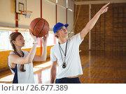 Купить «Male coach advising female basketball player», фото № 26677389, снято 18 февраля 2017 г. (c) Wavebreak Media / Фотобанк Лори