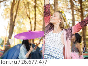 Купить «Happy woman with eyes closed raising hands at campsite», фото № 26677477, снято 9 марта 2017 г. (c) Wavebreak Media / Фотобанк Лори