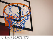 Купить «Low angle view of blue basket ball hoop», фото № 26678173, снято 18 февраля 2017 г. (c) Wavebreak Media / Фотобанк Лори