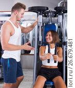 Купить «Instructor explaining how to train body», фото № 26679481, снято 5 июля 2020 г. (c) Яков Филимонов / Фотобанк Лори