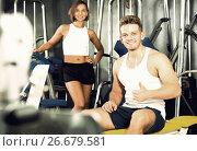 Купить «man taking break during workout in gym indoors», фото № 26679581, снято 4 октября 2016 г. (c) Яков Филимонов / Фотобанк Лори
