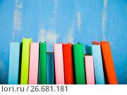 Купить «Stack of books on a blue background.», фото № 26681181, снято 24 июня 2017 г. (c) Елена Блохина / Фотобанк Лори