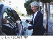 Купить «Businesswoman opening car door», фото № 26681781, снято 29 января 2017 г. (c) Wavebreak Media / Фотобанк Лори