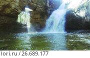 Купить «waterfall with crystal water located near the hole in the rock in Catalonia», видеоролик № 26689177, снято 30 апреля 2017 г. (c) Яков Филимонов / Фотобанк Лори