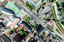 Aerial city view with crossroads and roads, houses, buildings, parks and parking lots. Sunny summer panoramic image, фото № 26689337, снято 23 июля 2017 г. (c) Александр Маркин / Фотобанк Лори