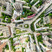 Aerial city view with crossroads and roads, houses, buildings, parks and parking lots. Sunny summer panoramic image, фото № 26689433, снято 25 июля 2017 г. (c) Александр Маркин / Фотобанк Лори
