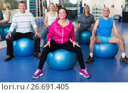 Купить «Group of people with balls in fitness club», фото № 26691405, снято 24 июня 2019 г. (c) Яков Филимонов / Фотобанк Лори
