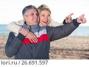 Купить «Positive husband points to something interesting», фото № 26691597, снято 24 января 2019 г. (c) Яков Филимонов / Фотобанк Лори