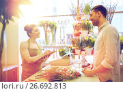 Купить «florist woman and man making order at flower shop», фото № 26692813, снято 27 марта 2016 г. (c) Syda Productions / Фотобанк Лори