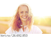 Купить «close up of happy young woman in white outdoors», фото № 26692853, снято 31 июля 2016 г. (c) Syda Productions / Фотобанк Лори