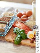 Купить «close up of natural protein food on table», фото № 26692961, снято 14 мая 2015 г. (c) Syda Productions / Фотобанк Лори