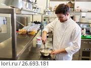 Купить «happy male chef cooking food at restaurant kitchen», фото № 26693181, снято 2 апреля 2017 г. (c) Syda Productions / Фотобанк Лори
