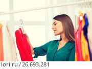 Купить «happy woman choosing clothes at home wardrobe», фото № 26693281, снято 19 февраля 2016 г. (c) Syda Productions / Фотобанк Лори