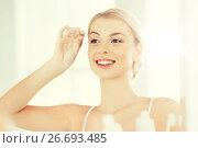 Купить «woman with tweezers tweezing eyebrow at bathroom», фото № 26693485, снято 13 февраля 2016 г. (c) Syda Productions / Фотобанк Лори