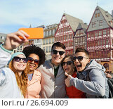 Купить «friends taking selfie by smartphone in frankfurt», фото № 26694009, снято 19 марта 2015 г. (c) Syda Productions / Фотобанк Лори