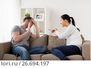 Купить «unhappy couple having argument at home», фото № 26694197, снято 20 января 2017 г. (c) Syda Productions / Фотобанк Лори