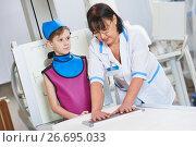 Купить «Nurse assistant with little boy preparing or x-ray radiography», фото № 26695033, снято 16 февраля 2017 г. (c) Дмитрий Калиновский / Фотобанк Лори