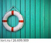 Life belt or rescue ring on wooden wall. Salvation, protection. Стоковое фото, фотограф Maksym Yemelyanov / Фотобанк Лори