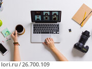 Купить «woman hands with camera working on laptop at table», фото № 26700109, снято 22 марта 2017 г. (c) Syda Productions / Фотобанк Лори