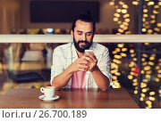 Купить «happy man with smartphone and coffee at restaurant», фото № 26700189, снято 8 ноября 2015 г. (c) Syda Productions / Фотобанк Лори