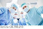 Купить «group of surgeons in operating room at hospital», фото № 26700213, снято 23 декабря 2015 г. (c) Syda Productions / Фотобанк Лори