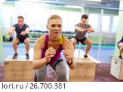 Купить «group of people doing box jumps exercise in gym», фото № 26700381, снято 19 февраля 2017 г. (c) Syda Productions / Фотобанк Лори