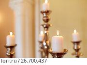 Купить «candles burning in church», фото № 26700437, снято 20 марта 2017 г. (c) Syda Productions / Фотобанк Лори