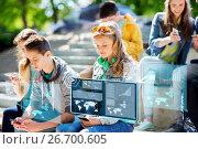 Купить «teenage friends with smartphones outdoors», фото № 26700605, снято 21 мая 2016 г. (c) Syda Productions / Фотобанк Лори