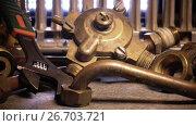 Купить «Details of water and gas fittings of the heater of water and metalwork tool adjustable wrench», видеоролик № 26703721, снято 24 июля 2009 г. (c) Куликов Константин / Фотобанк Лори