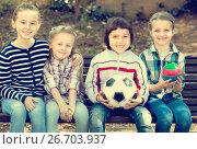 Купить «Kids posing together with ball», фото № 26703937, снято 20 июня 2018 г. (c) Яков Филимонов / Фотобанк Лори