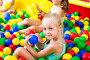 Girl playing with multicolored plastic balls, фото № 26703981, снято 26 июля 2017 г. (c) Яков Филимонов / Фотобанк Лори