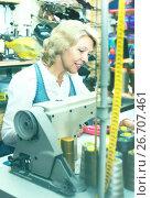 Купить «Mature woman sewing with professional machine», фото № 26707461, снято 21 февраля 2020 г. (c) Яков Филимонов / Фотобанк Лори